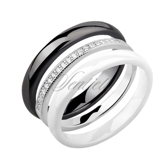 Two ceramic rings black + white and silver ring with zirconia