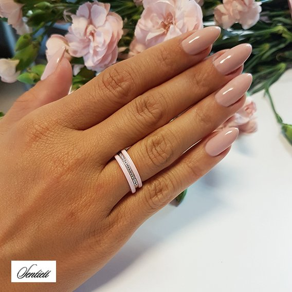 Two pink ceramic rings and silver ring with zirconia